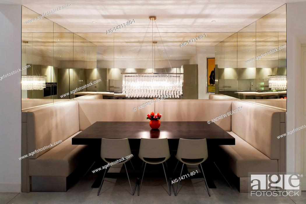 Picture of: Dining Table Alcove With Built In High Back Benches Mirrored Walls And Hanging Glass Pendant Light Stock Photo Picture And Rights Managed Image Pic Aig 14711 80 1 Agefotostock