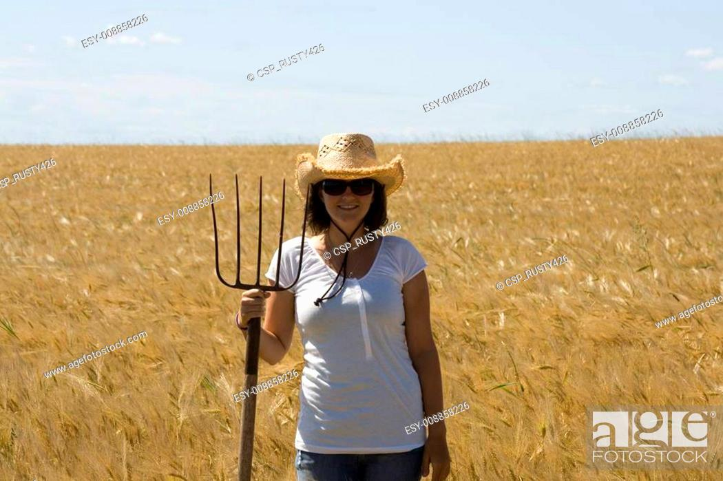 Stock Photo: Woman holds a fork.
