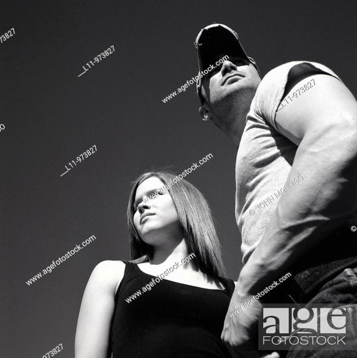 Stock Photo: Man and woman looking away from each other.