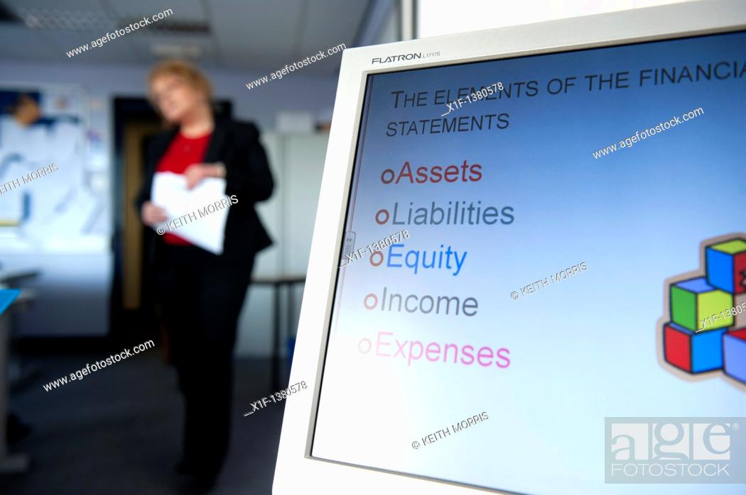Stock Photo: A person making a presentation of financial information in an office, UK.
