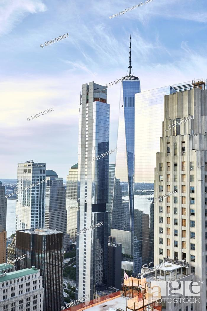 Stock Photo: A skyline photograph of NYC featuring the Freedom Tower and blue skies.