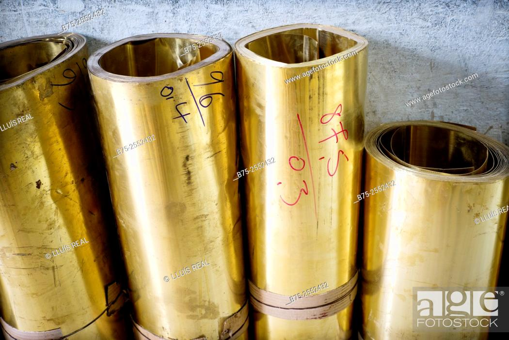 Stock Photo: Brass rolls in a warehouse of metals in the medina of Fez, Morocco, Africa.