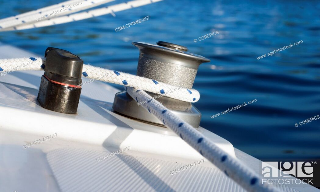 Stock Photo: Winch, sheet, and clamp of a small dinghy in the evening light.