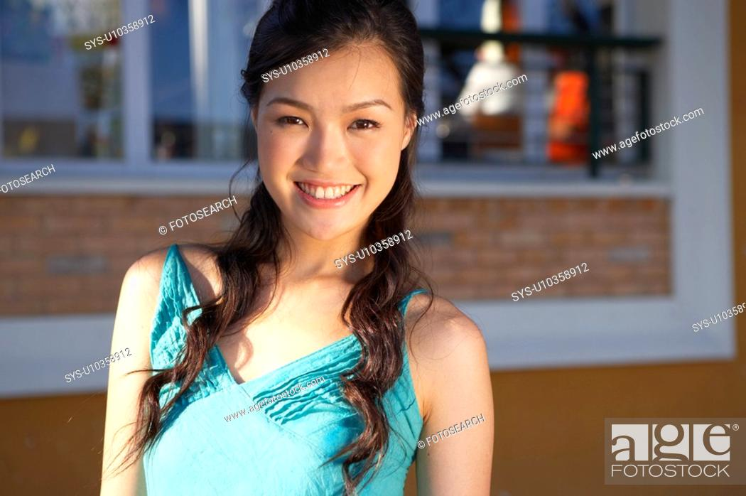Stock Photo: Young Lady Standing in Street.