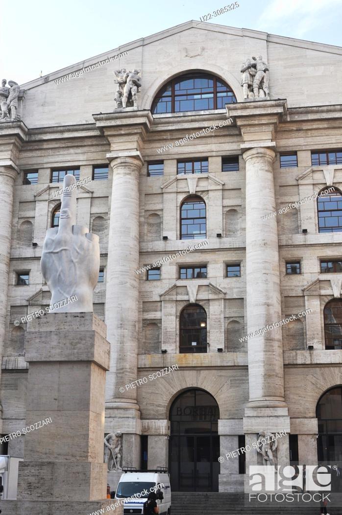 Stock Photo: Milan, Italy: L.O.V.E. ('The Finger') sculpture by Maurizio Cattelan, facing Palazzo Mezzanotte (Stock Exchange Building) in Piazza degli Affari.