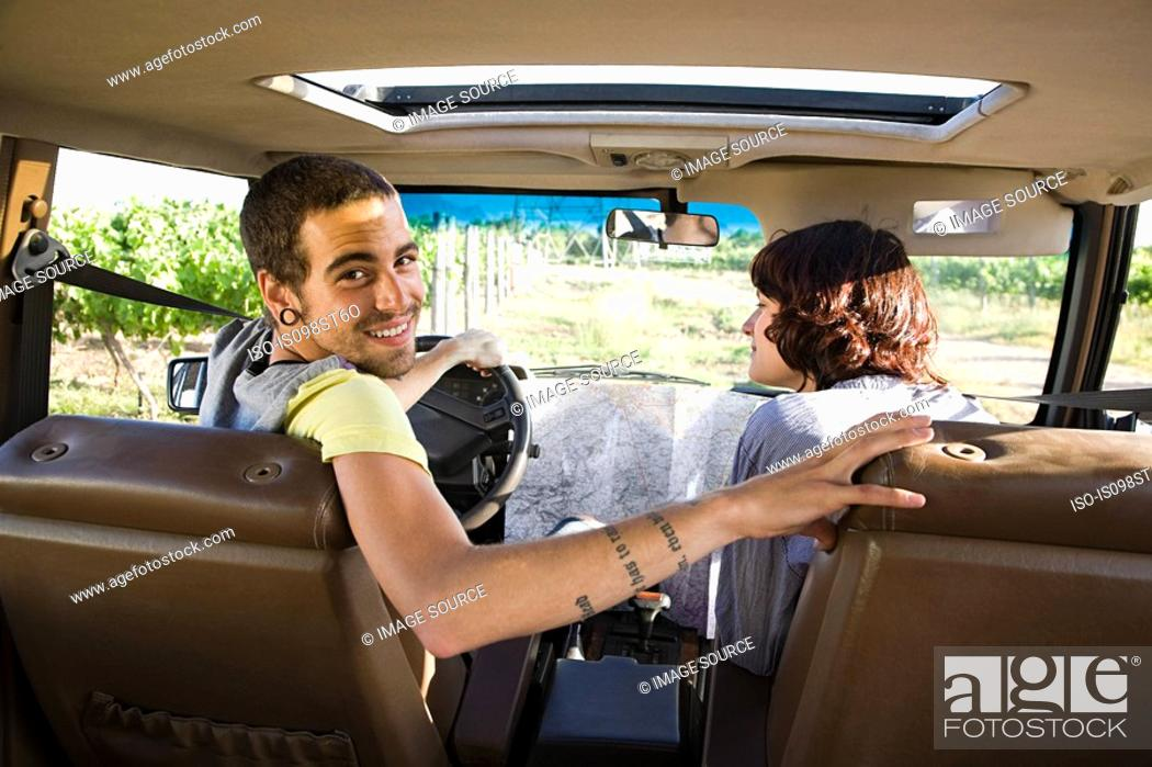 Stock Photo: Young couple in vehicle.