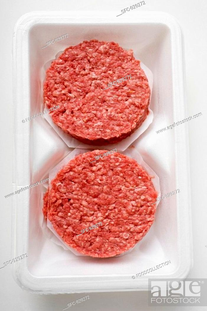 Stock Photo: Raw burgers for hamburgers in packaging.