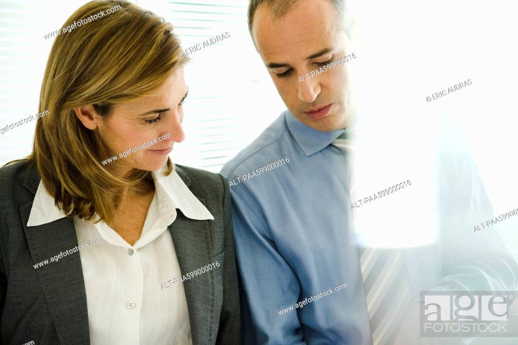 Stock Photo: Business associates talking.