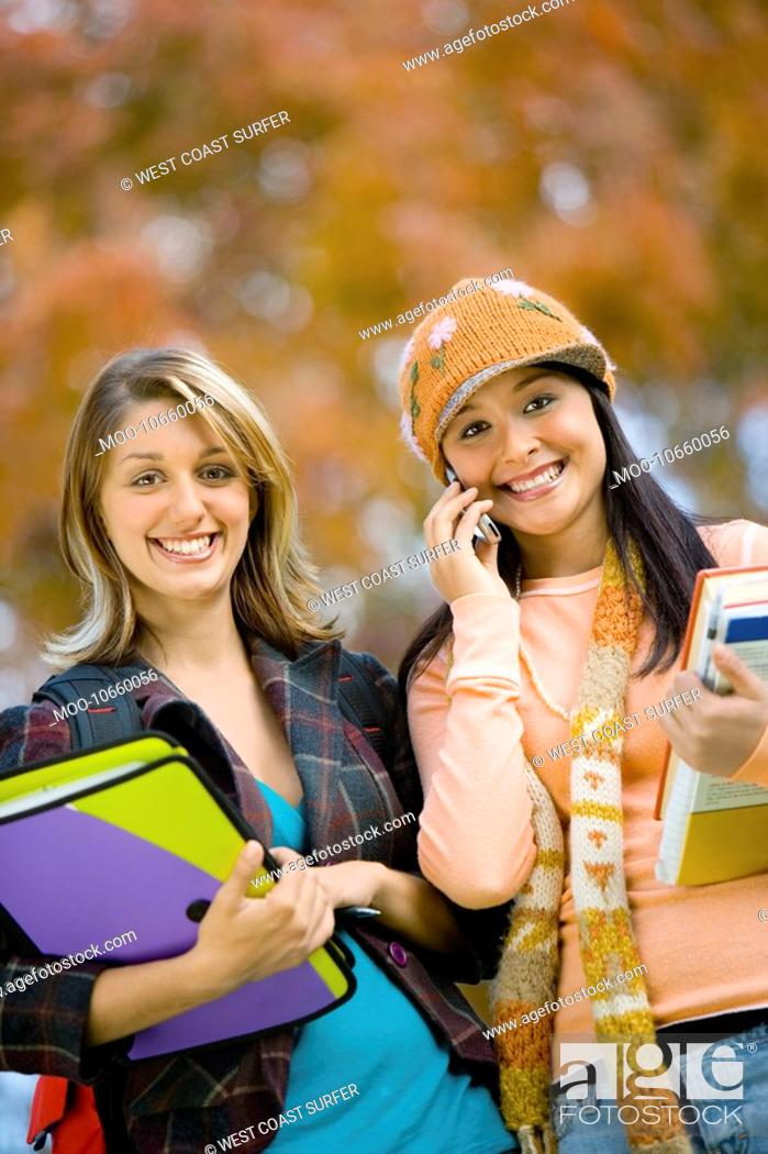 Stock Photo: Two female students outdoors portrait.