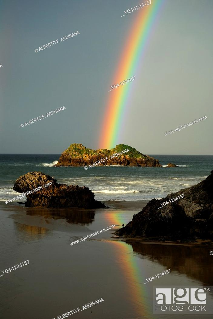 Stock Photo: Rainbow over the beach Celorio Llanes, Asturias.