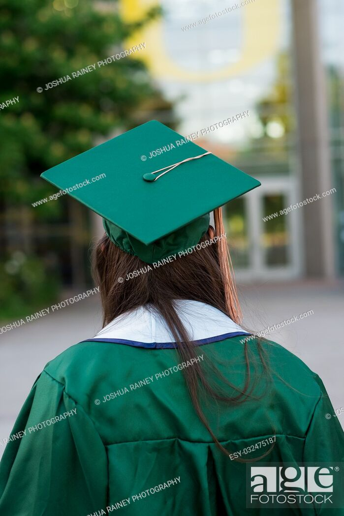 Stock Photo: Pretty girl posing for a graduation photo on campus during her senior year of college right before graduation.