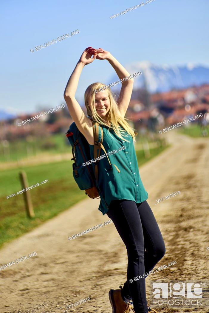 Photo de stock: Vibrant woman hiking at country side. Waakirchen, Bavaria, Germany.