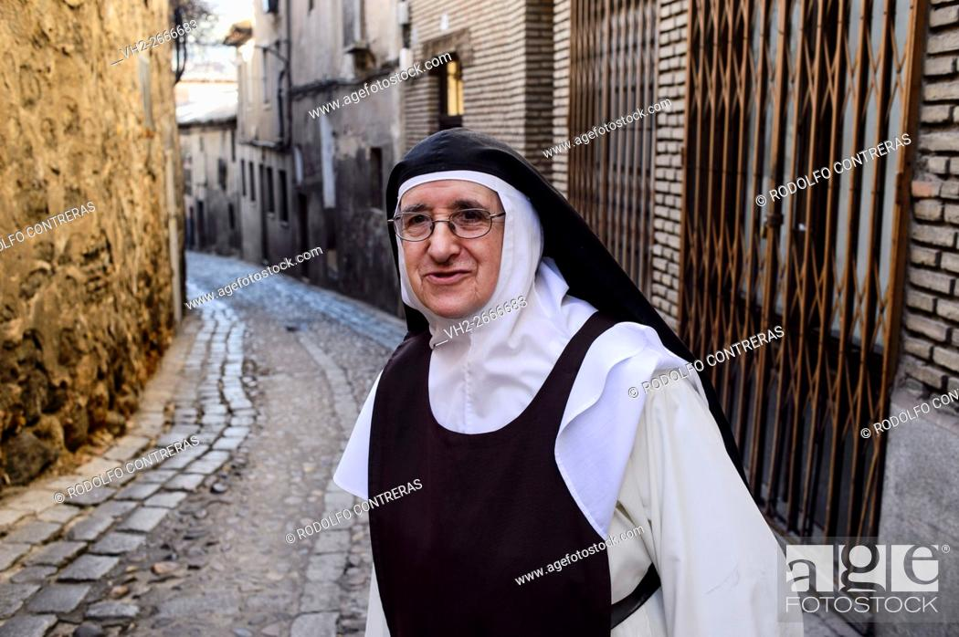 Stock Photo: Nun in the old quarter, Toledo.