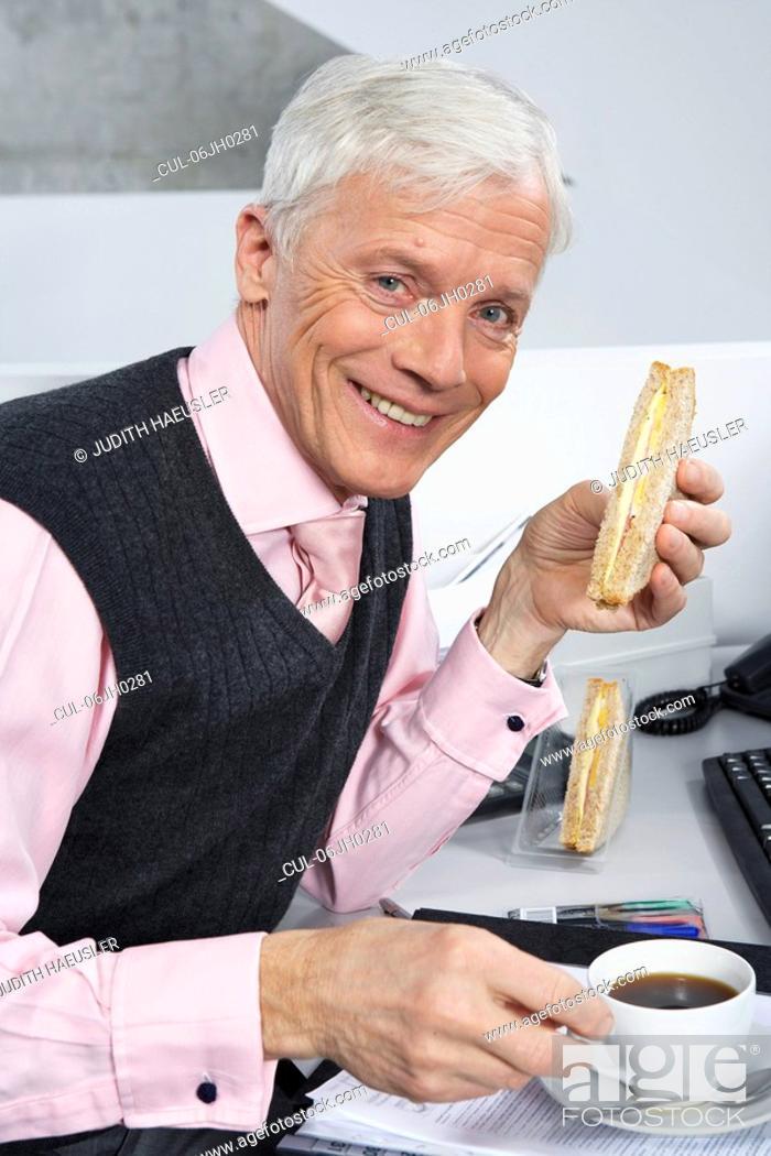 Stock Photo: Businessman having light bite.