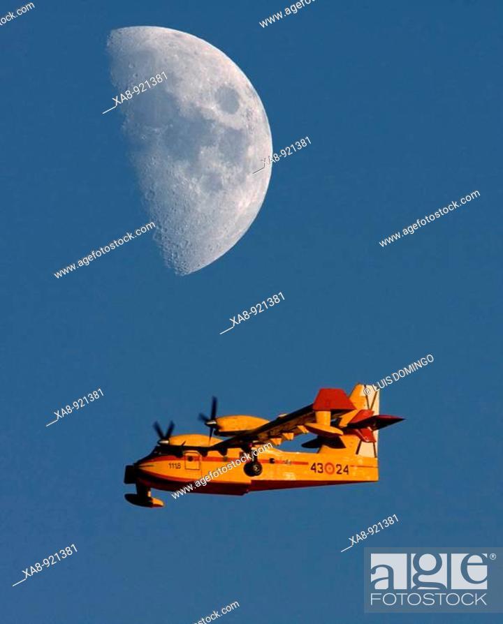 Stock Photo: Seaplane and moon.