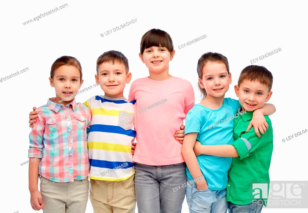 Stock Photo: childhood, fashion, friendship and people concept - group of happy smiling little children hugging.