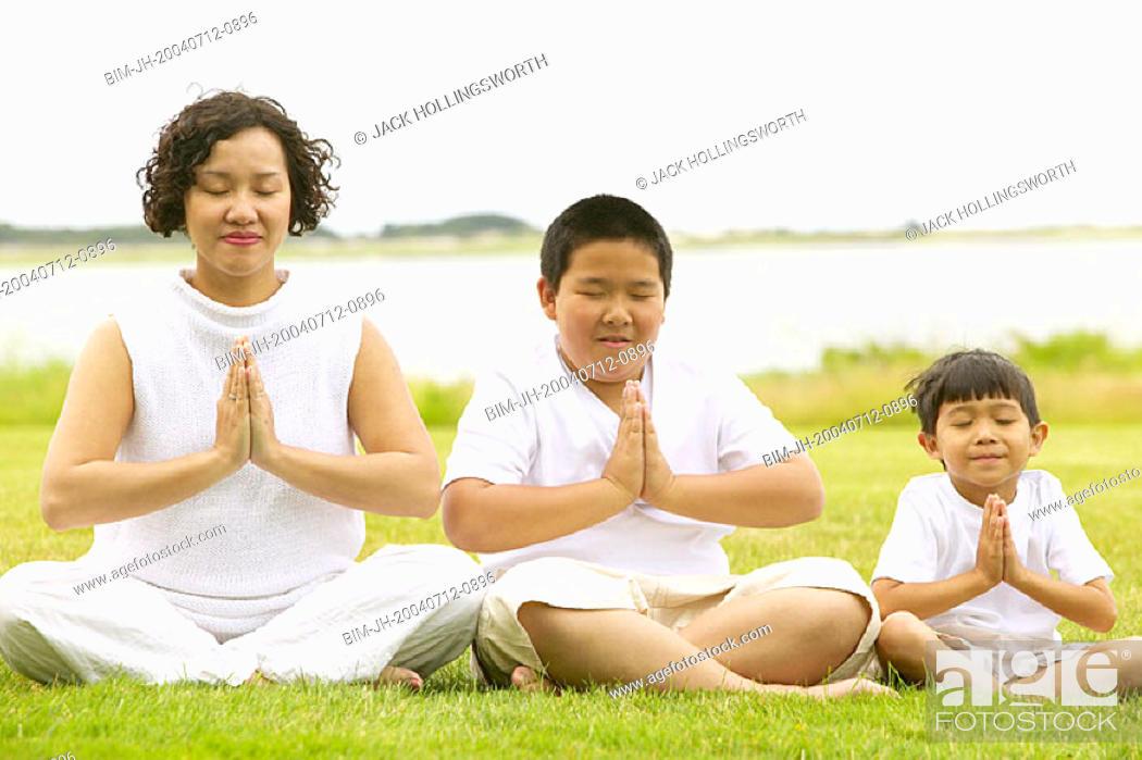Stock Photo: Family meditating.