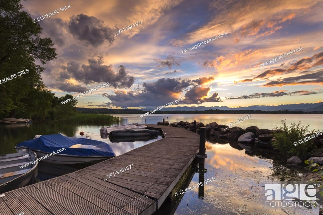 Stock Photo: A summer sunset reflecting on Lake Varese at Cazzago Brabbia harbour, Varese Province, Lombardy, Italy.