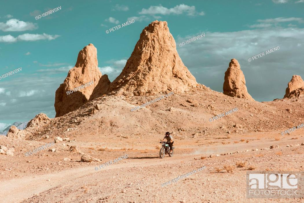 Stock Photo: Motorcyclist riding in desert, Trona Pinnacles, California, US.