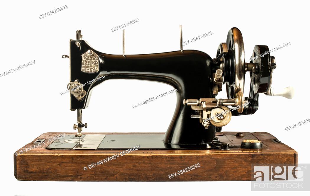 Stock Photo: Vintage sewing machine white isolated.