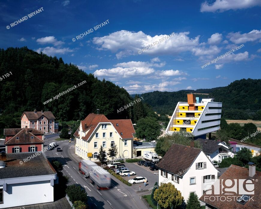 Stock Photo: STO - Building K Stuhlingen. Modern office building in the context of the old town, road and countryside buildings raised stilts.