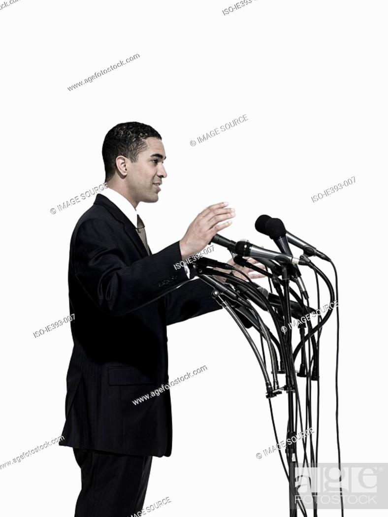 Stock Photo: Politician and microphones.