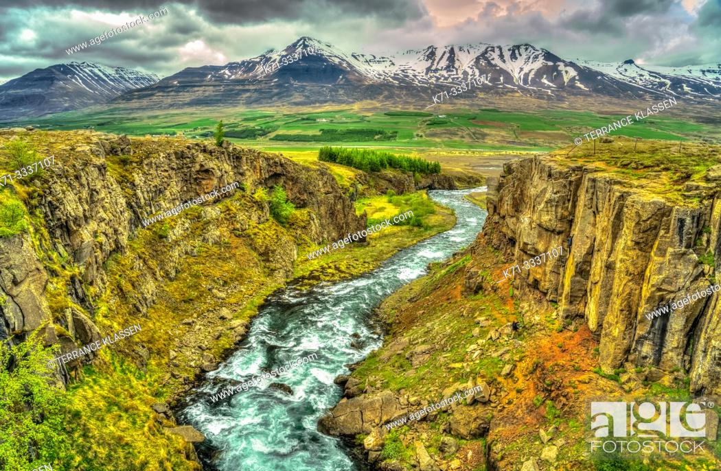 Imagen: A scenic landscape view of mountains and a stream near Akureyri, Iceland, Europe.