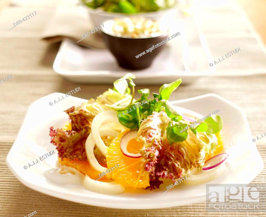 Stock Photo: Orange and lamb's lettuce fresh salad.