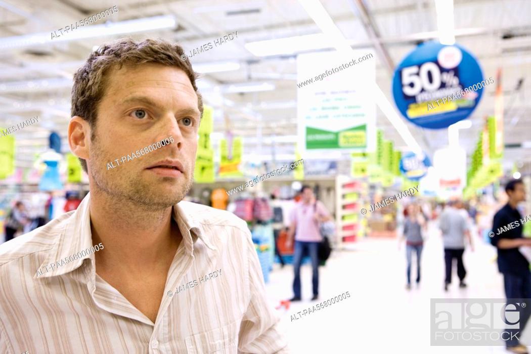 Stock Photo: Man in supermarket.