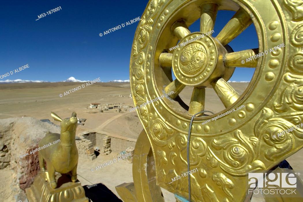 Stock Photo: the Golden Dharma Wheel on the terrace of the chiu monastery  chiu village  shigatse prefecture  Tibet  China.