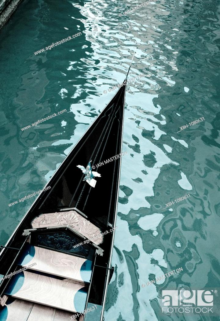 Stock Photo: Toned image of gondola on canal in Venice Italy.