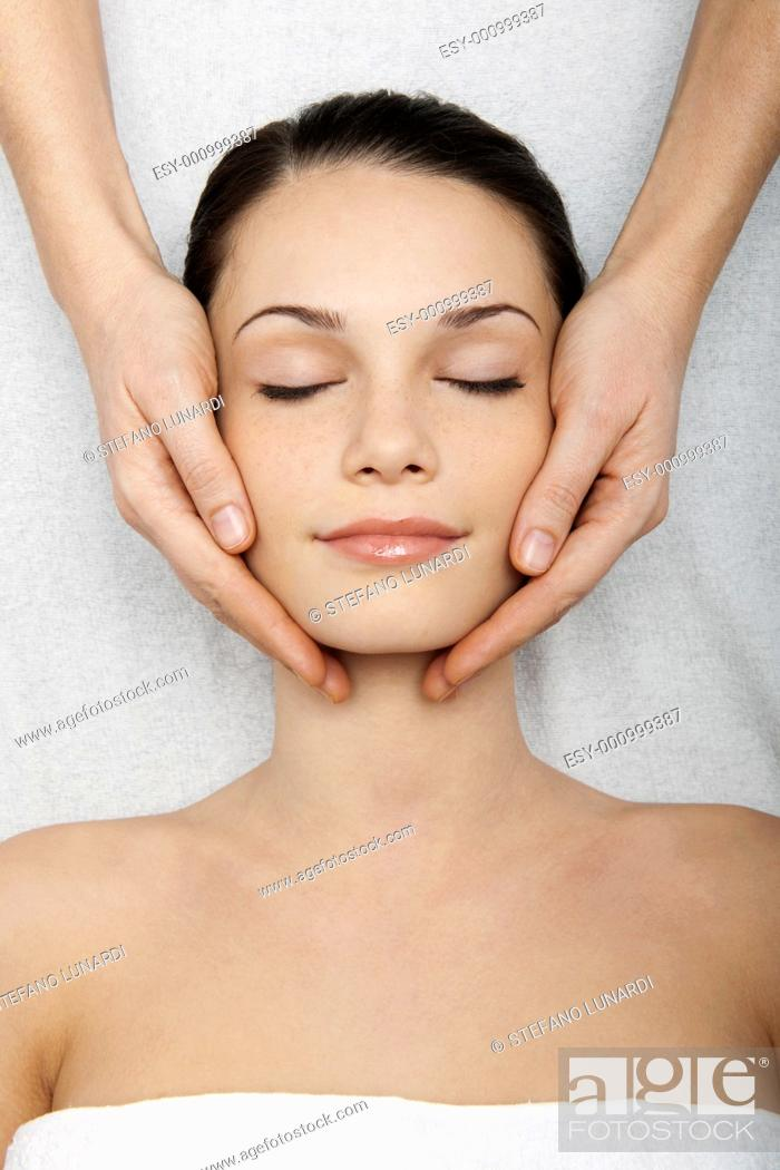 Stock Photo: Young woman receiving head massage.