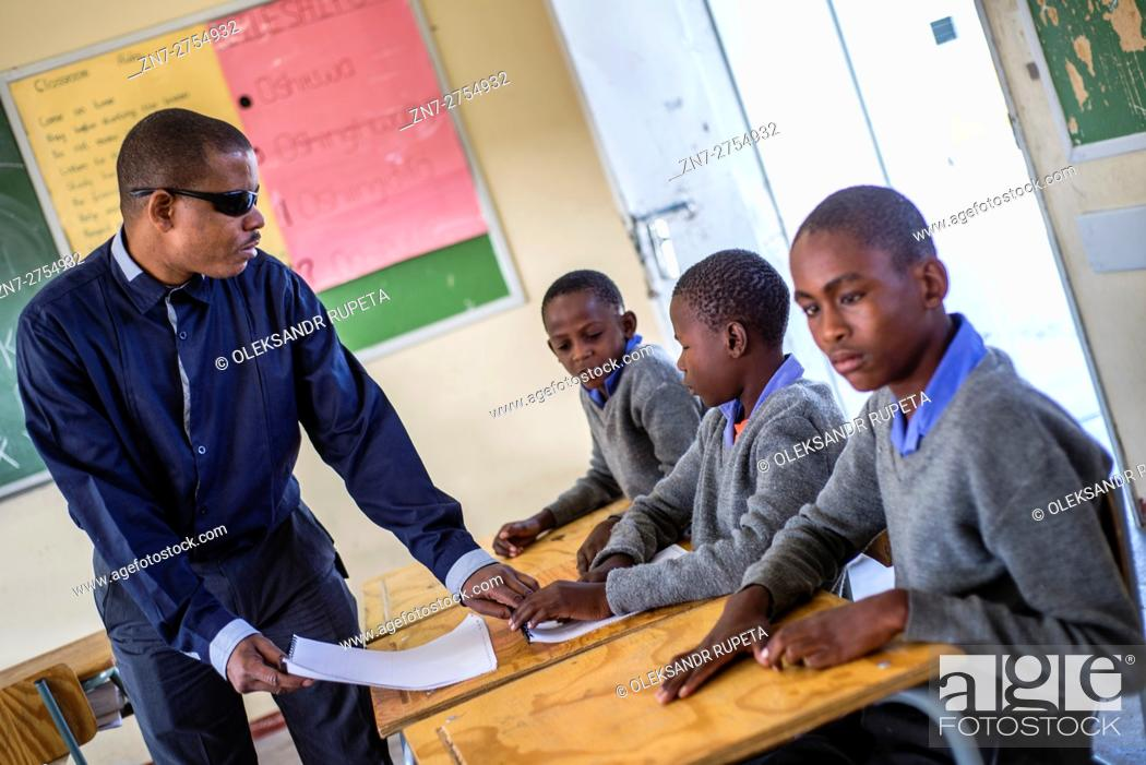 Stock Photo: The teacher Tobias Mwaudikange has a lesson of natural science with the 4th grade of visually impaired children at Eluwa Special School in Ongwediva, Namibia.