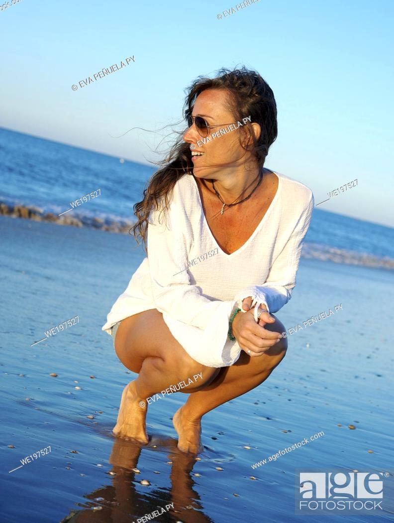 Stock Photo: young girl enjoying comfortable morning clothes on the Islantilla beach, Huelva.