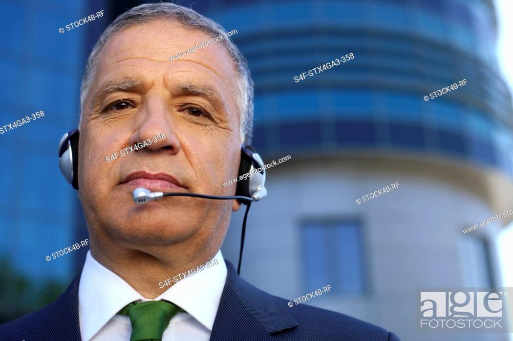 Stock Photo: Mature man with headset.