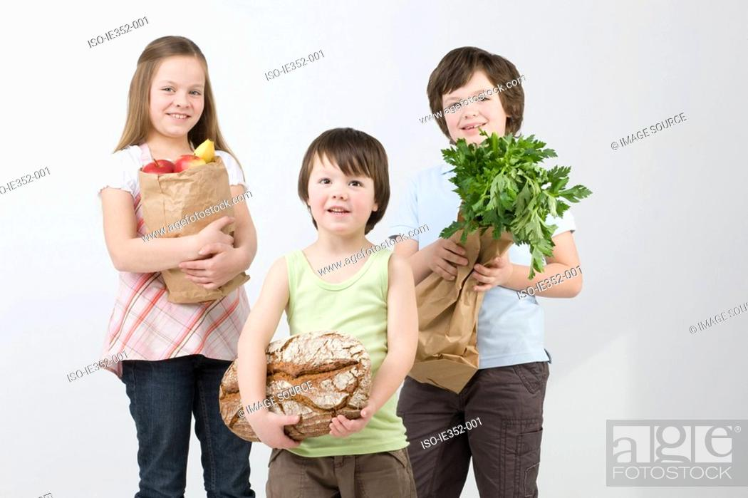 Stock Photo: Children with groceries.