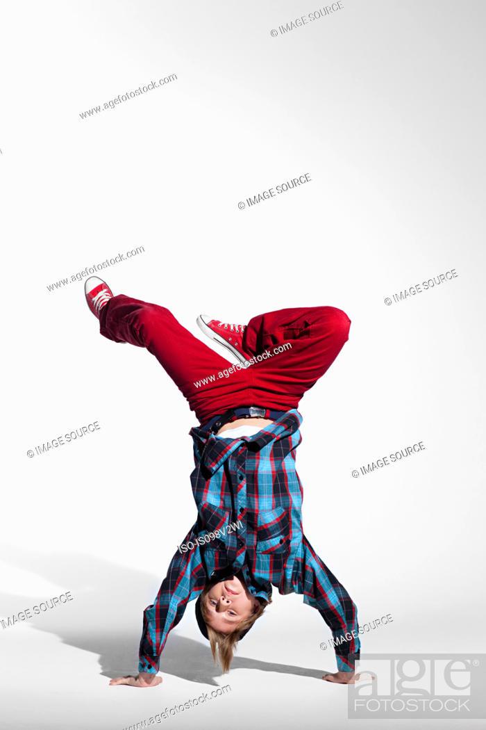 Stock Photo: Teenage boy doing a handstand.
