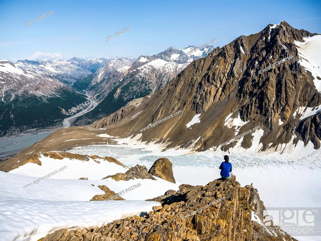 Stock Photo: Woman enjoying an afternoon amongst the mountains and glaciers of Kluane National Park and Reserve; Haines Junction, Yukon, Canada.