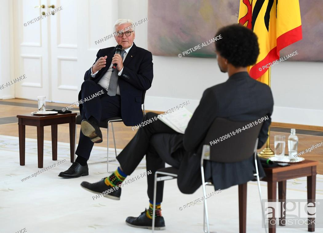 """Stock Photo: 16 June 2020, Berlin: Federal President Frank-Walter Steinmeier (l) talks to his guest Daniel Gyamerah, head of the """"""""Advocating for Inclusion"""""""" department of."""