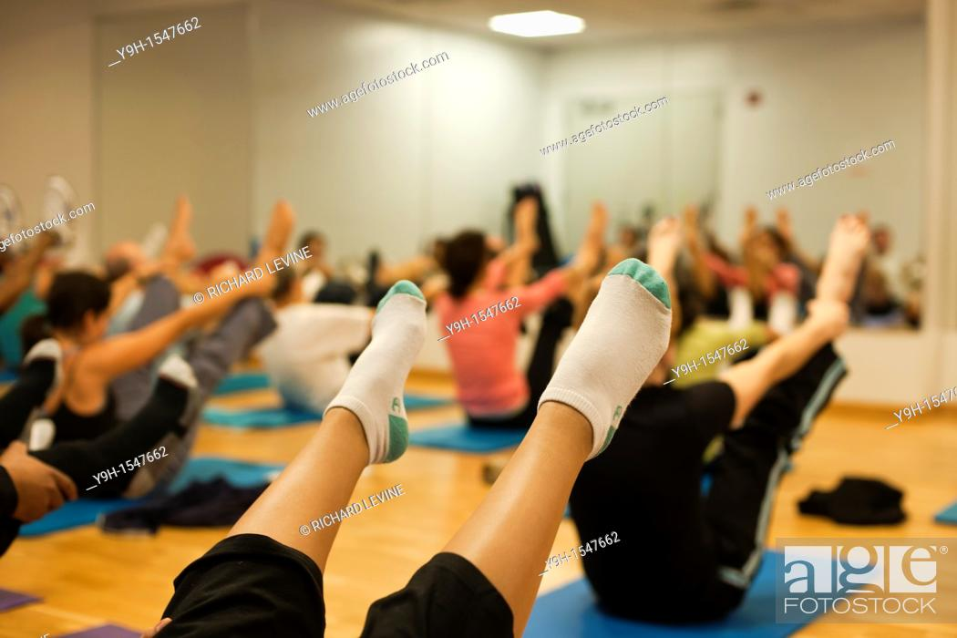 Stock Photo: Exercisers participate in a pilates class at the Chelsea Recreation Center in New York.