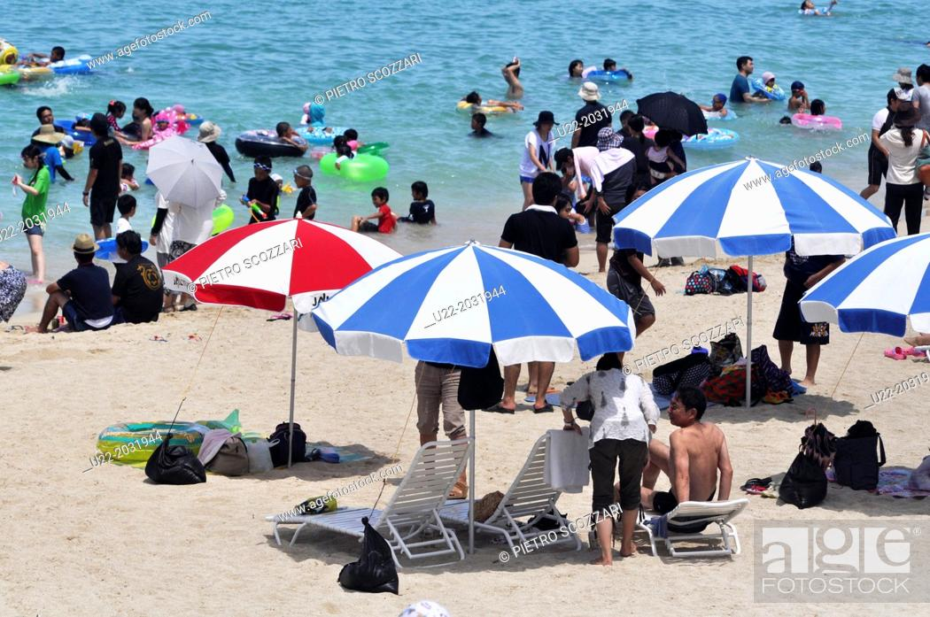 Stock Photo: Okinawa, Japan, people bathing at Chura Sun Beach.