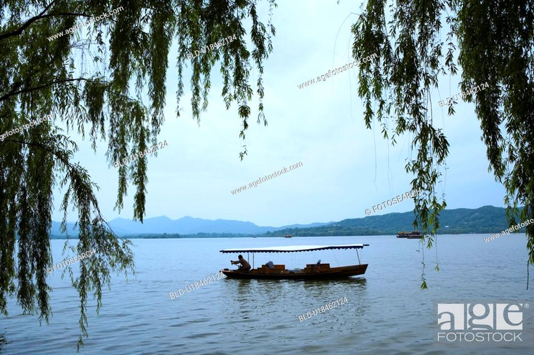 Stock Photo: Boat on West Lake in Hangzhou, People's Republic of China.