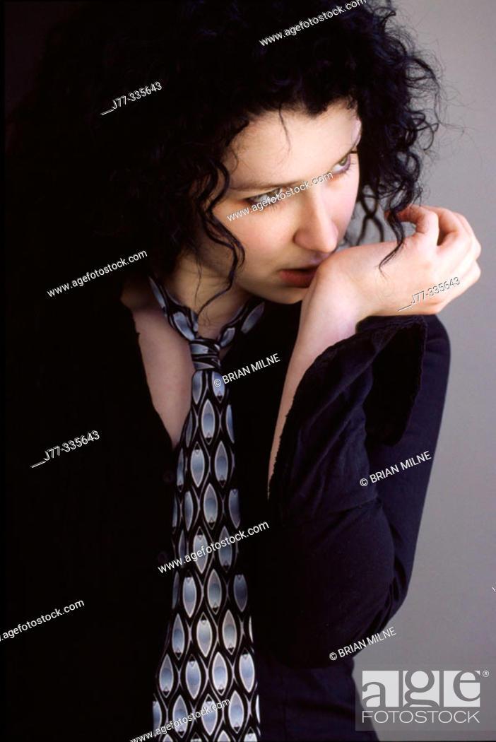 Stock Photo: Woman smelling perfume on wrist.
