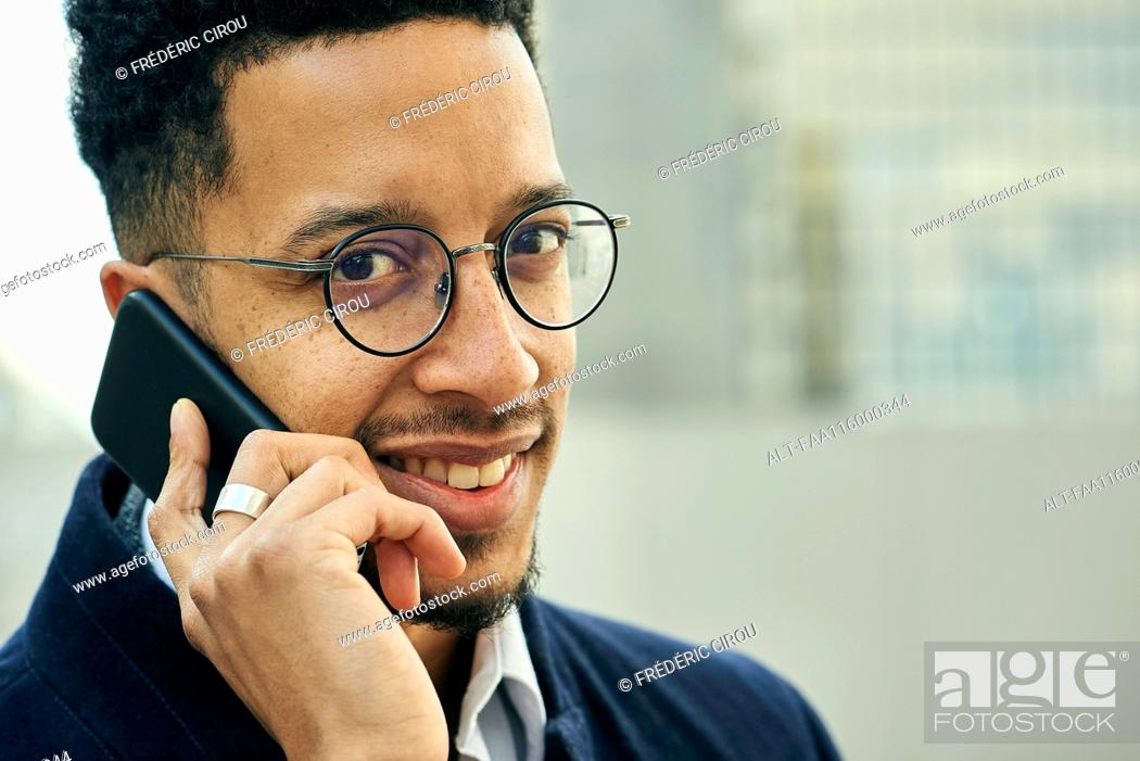 Stock Photo: Close-up of businessman talking on smartphone.
