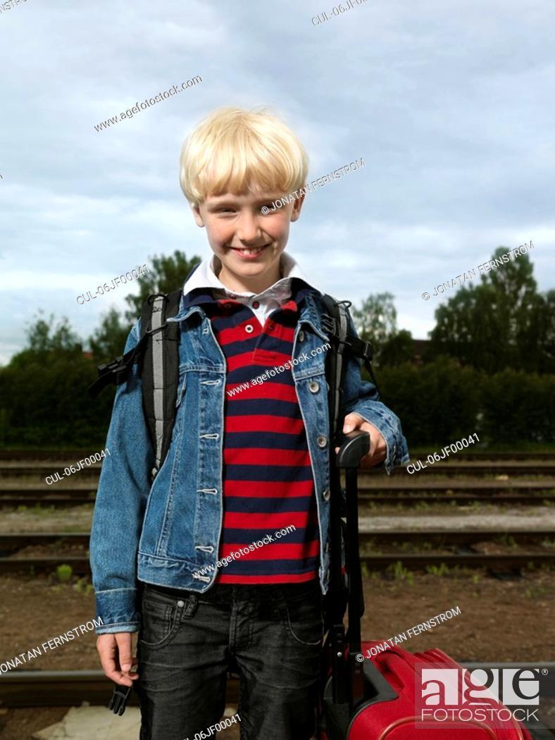 Stock Photo: Boy on train station.