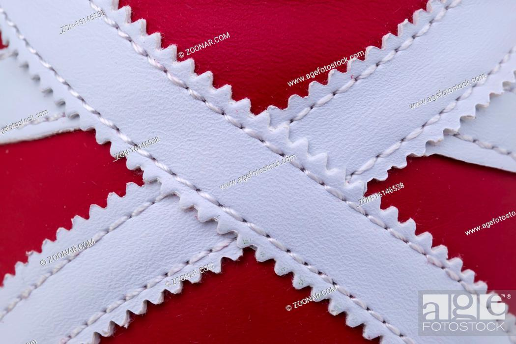 Stock Photo: Fragment of red and white sneaker fabric. The texture of the material of sports shoes.