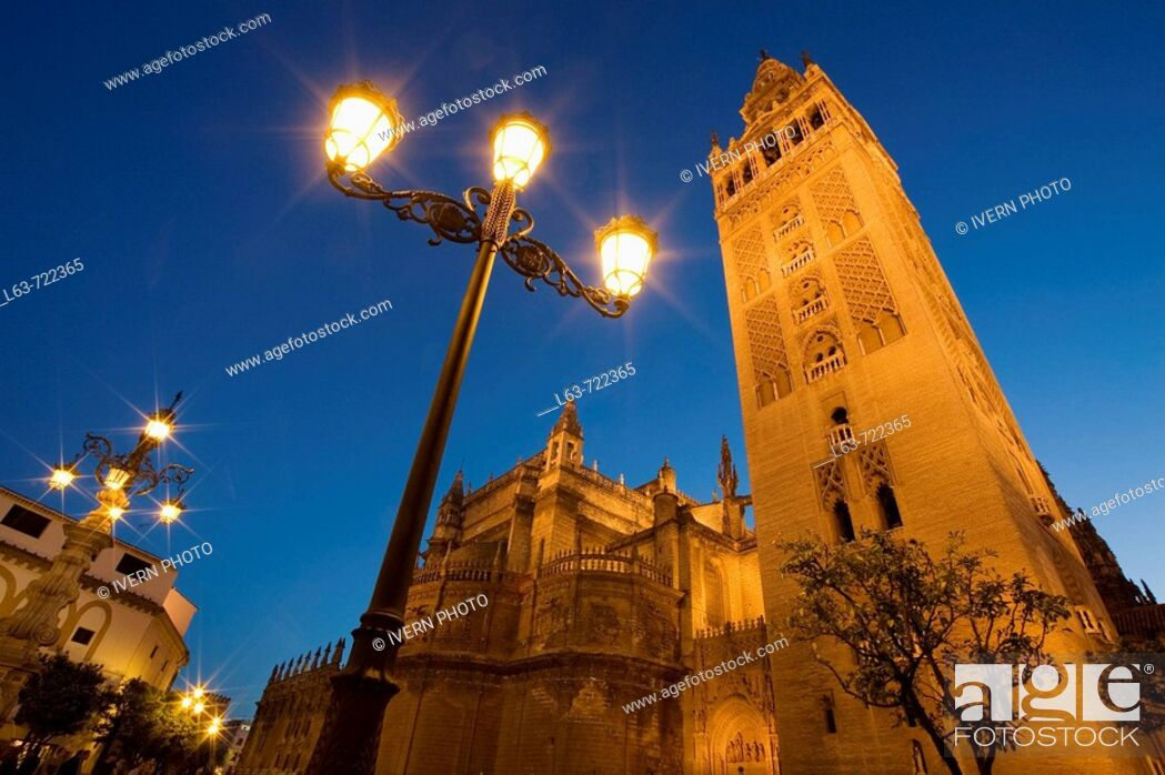 Stock Photo: Giralda tower and cathedral at night, Sevillla. Andalucia, Spain.
