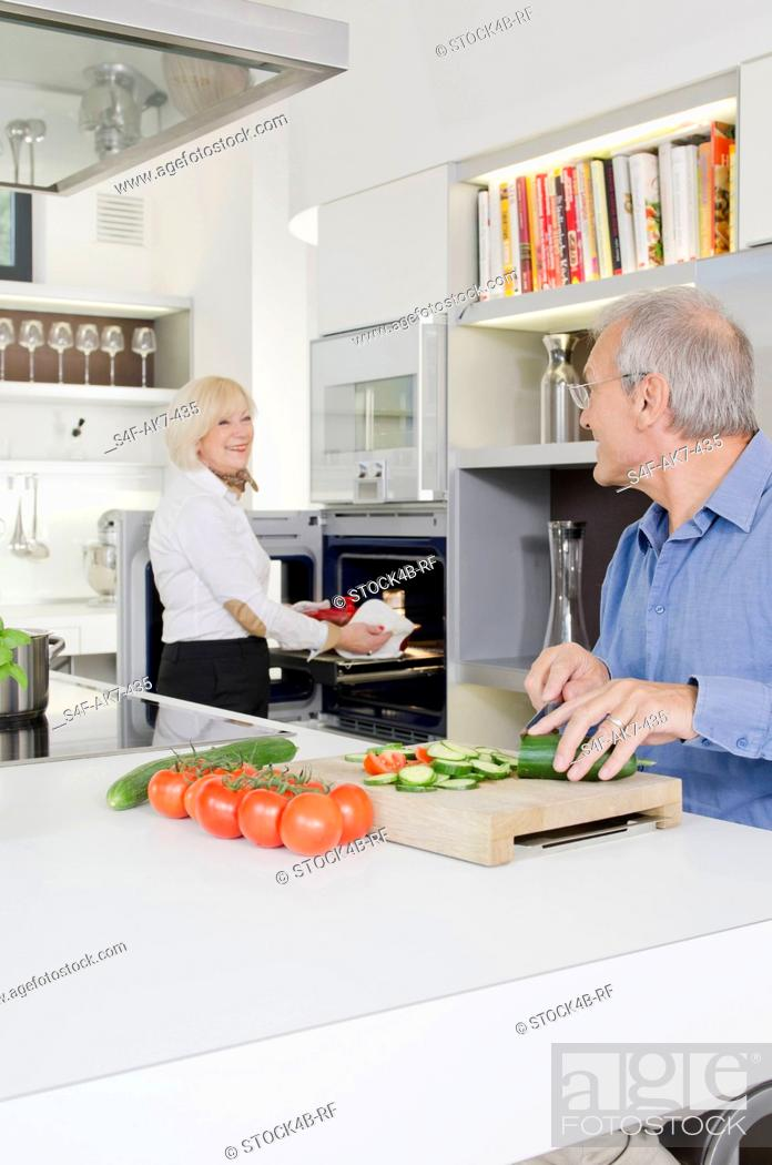 Stock Photo: Senior couple preparing healthy meal in kitchen.