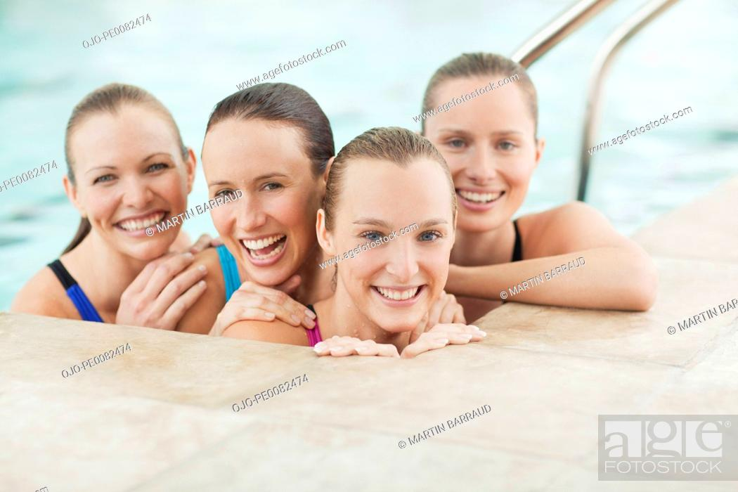 Stock Photo: Portrait of smiling young women in swimming pool.