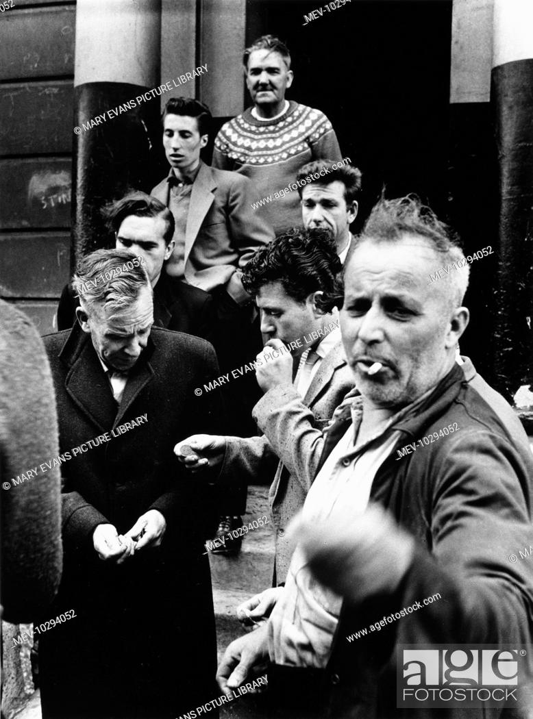 A Group Of Men Coming Out Of A House In Southam Street North